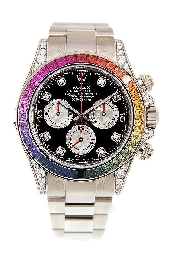 A silver rolex with a rainbow diamond bezel and black face
