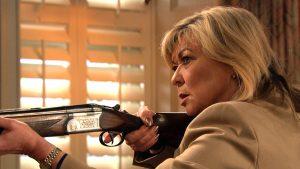 A terrified Kim fires her gun in Emmerdale